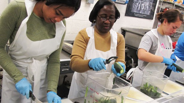 Volunteers from DC Central Kitchen prep food. Photo via Flickr Creative Commons from @dccentralkitchen.