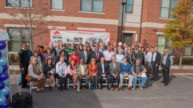 Officials from the City of Alexandria, ARHA, EYA and community and business leaders at the Old Town Commons Completion Ceremony