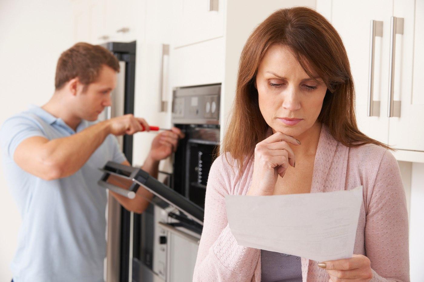 Woman Reviewing Repair Bill